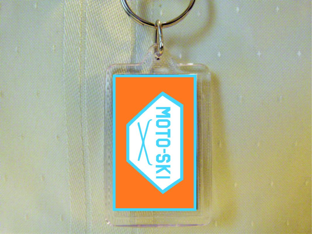 MotoSki Cross Skis Acrylic White Keychain